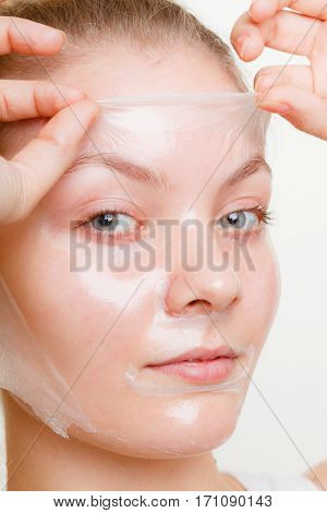 Woman Removing Facial Peel Off Mask.