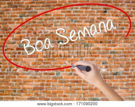 Woman Hand Writing Boa Semana   (good Weekin Portuguese)with Black Marker On Visual Screen