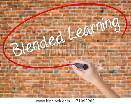 Woman Hand Writing Blended Learning   With Black Marker On Visual Screen