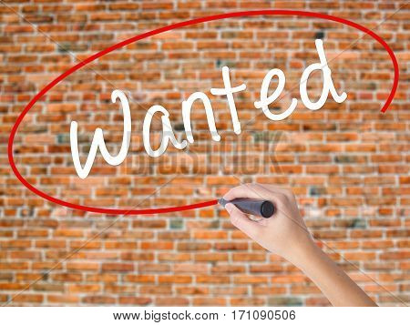 Woman Hand Writing Wanted With Black Marker On Visual Screen.