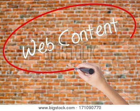 Woman Hand Writing Web Content With Black Marker On Visual Screen