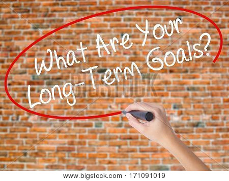 Woman Hand Writing What Are Your Long-term Goals? With Black Marker On Visual Screen