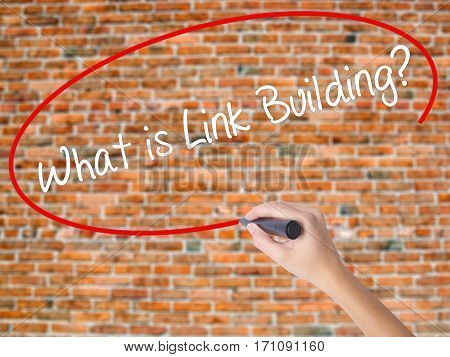 Woman Hand Writing What Is Link Building? With Black Marker On Visual Screen