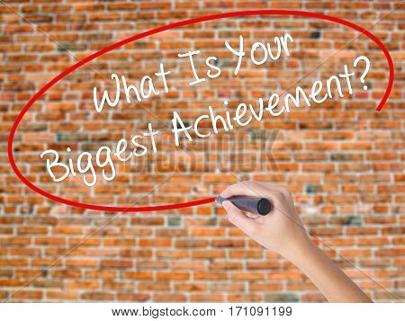 Woman Hand Writing What Is Your Biggest Achievement? With Black Marker On Visual Screen