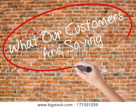 Woman Hand Writing What Our Customers Are Saying With Black Marker On Visual Screen