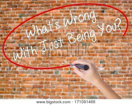 Woman Hand Writing What's Wrong With Just Being You? With Black Marker On Visual Screen