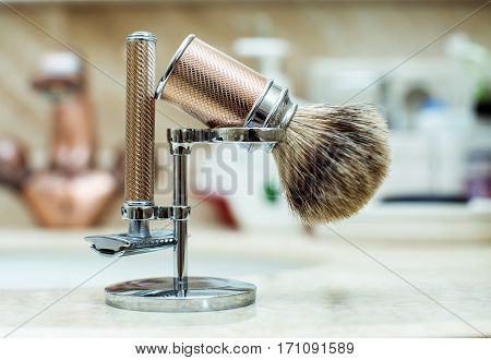 Razor and Shaving Brush in a bath room