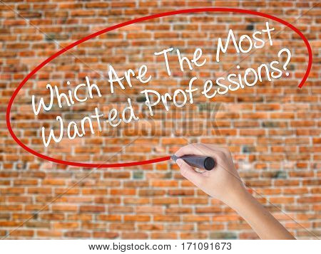 Woman Hand Writing Which Are The Most Wanted Professions? With Black Marker On Visual Screen