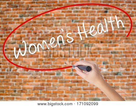 Woman Hand Writing Women's Health With Black Marker On Visual Screen