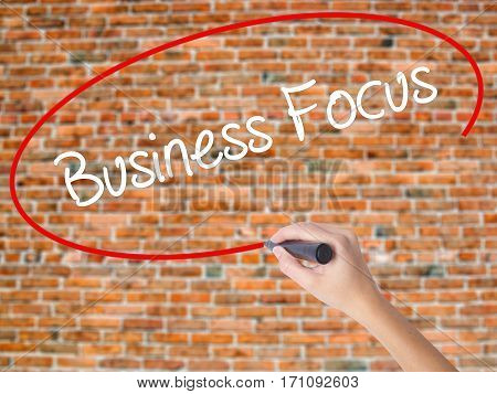Woman Hand Writing Business Focus With Black Marker On Visual Screen.