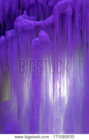 the colored frozen blocks of ice stalactites