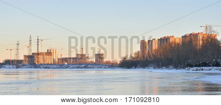 View of Neva River on the outskirts of St. Petersburg at sunny winter evening Russia.