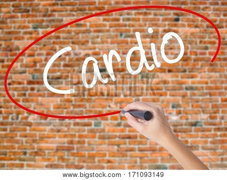 Woman Hand Writing Cardio With Black Marker On Visual Screen