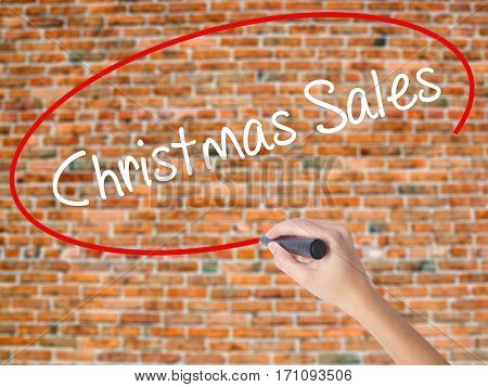 Woman Hand Writing Christmas Sales With Black Marker On Visual Screen