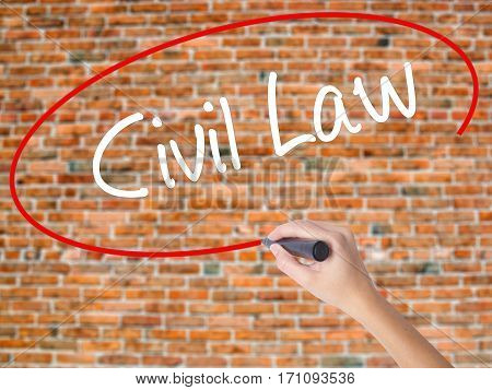 Woman Hand Writing Civil Law With Black Marker On Visual Screen