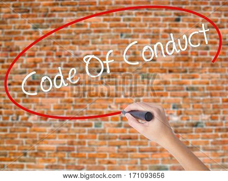Woman Hand Writing Code Of Conduct With Black Marker On Visual Screen