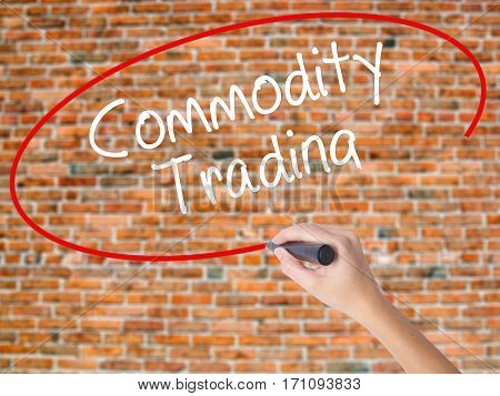 Woman Hand Writing Commodity Trading With Black Marker On Visual Screen.