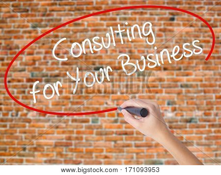 Woman Hand Writing Consulting For Your Business With Black Marker On Visual Screen