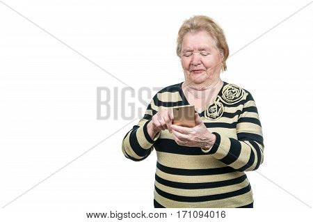 Old woman uses a smartphone by clicking on it with your finger isolated on white background