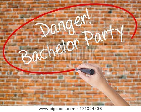 Woman Hand Writing Danger! Bachelor Party With Black Marker On Visual Screen