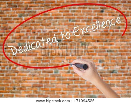 Woman Hand Writing Dedicated To Excellence  With Black Marker On Visual Screen