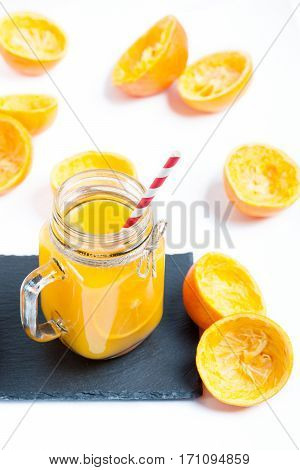 Orange juice in glass on a white background