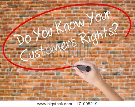 Woman Hand Writing Do You Know Your Customers Rights? With Black Marker On Visual Screen.