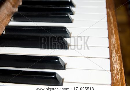 close-up of old piano keys frontal view