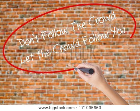 Woman Hand Writing Don't Follow The Crowd Let The Crowd Follow You With Black Marker On Visual Scree