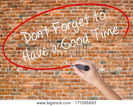 Woman Hand Writing Don't Forget To Have A Good Time With Black Marker On Visual Screen