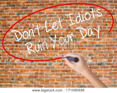 Woman Hand Writing Don't Let Idiots Ruin Your Day With Black Marker On Visual Screen