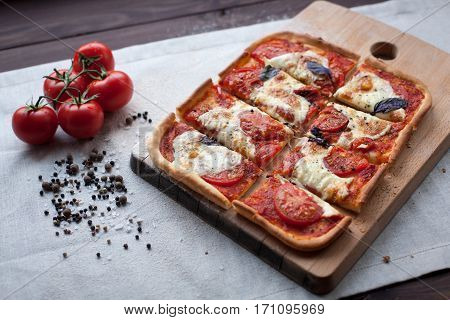 rustic italian pizza with mozzarella, cheese and basil leaves. vegetarian food