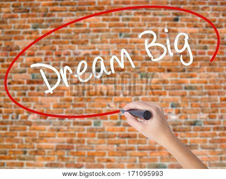 Woman Hand Writing Dream Big  With Black Marker On Visual Screen