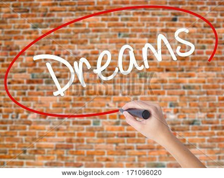 Woman Hand Writing Dreams With Black Marker On Visual Screen