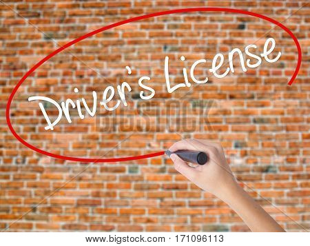 Woman Hand Writing Drivers License With Black Marker On Visual Screen