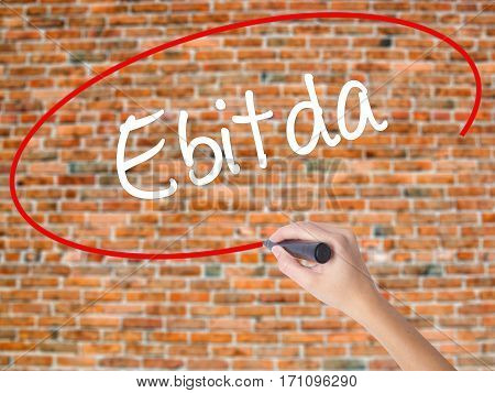 Woman Hand Writing Ebitda  With Black Marker On Visual Screen