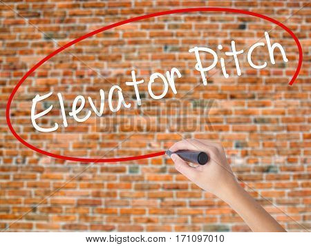 Woman Hand Writing Elevator Pitch With Black Marker On Visual Screen