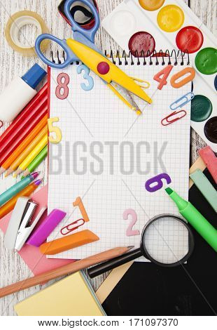 Assorted school supplies with a notebooks pencils pens scissors etc