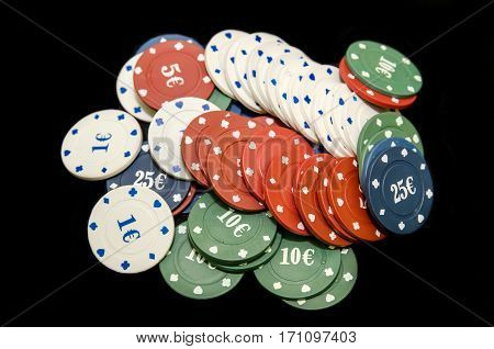 Casino chips isolated on black background close up