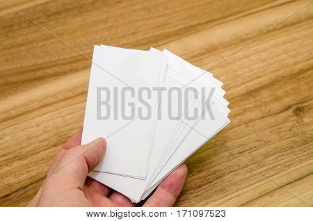 business card presentation for promotion on wooden table