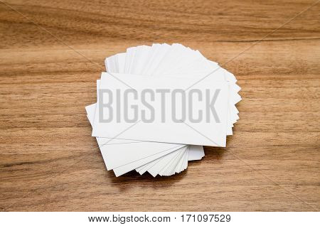 Formal style business cards presentation on wooden background