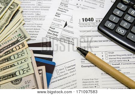 Heap of tax form credit cards the calculator a ball pen and money