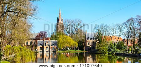 Banner lake panorama, reflection of gothic house, blue sky, spring in Bruges, Belgium