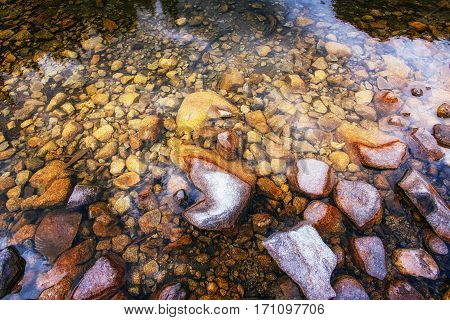 Stones in the transparent lake. Beauty world