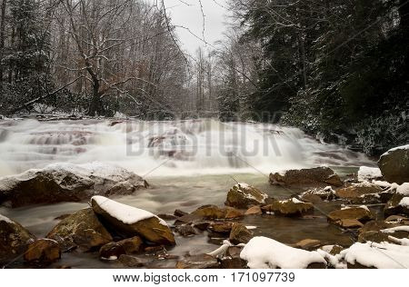 Winter snow shot of waterfall with blurred motion on Muddy Creek running into Cheat River off Route 26 in Preston County West Virginia