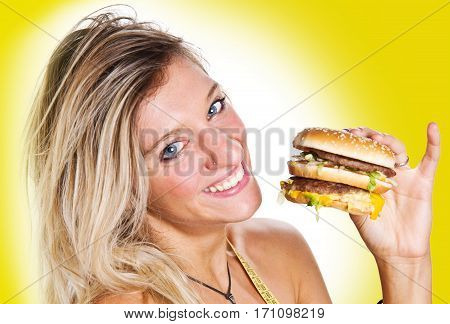 a smiling girl with burger in hand
