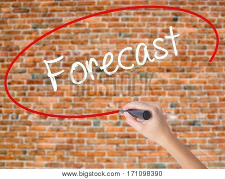 Woman Hand Writing Forecast With Black Marker On Visual Screen