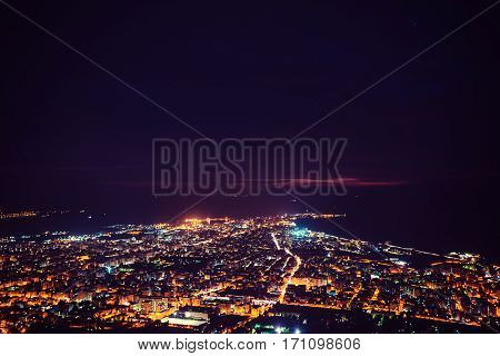 Fantastic aerial view of city illuminated with lights. Location Trapani, Erice, Sicilia, Italy, Europe. Mediterranean and Tyrrhenian sea.
