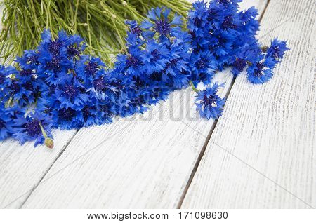 Bouquet of cornflowers on a wooden background