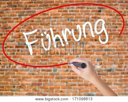 Woman Hand Writing Fuhrung (leadership In German) With Black Marker On Visual Screen.